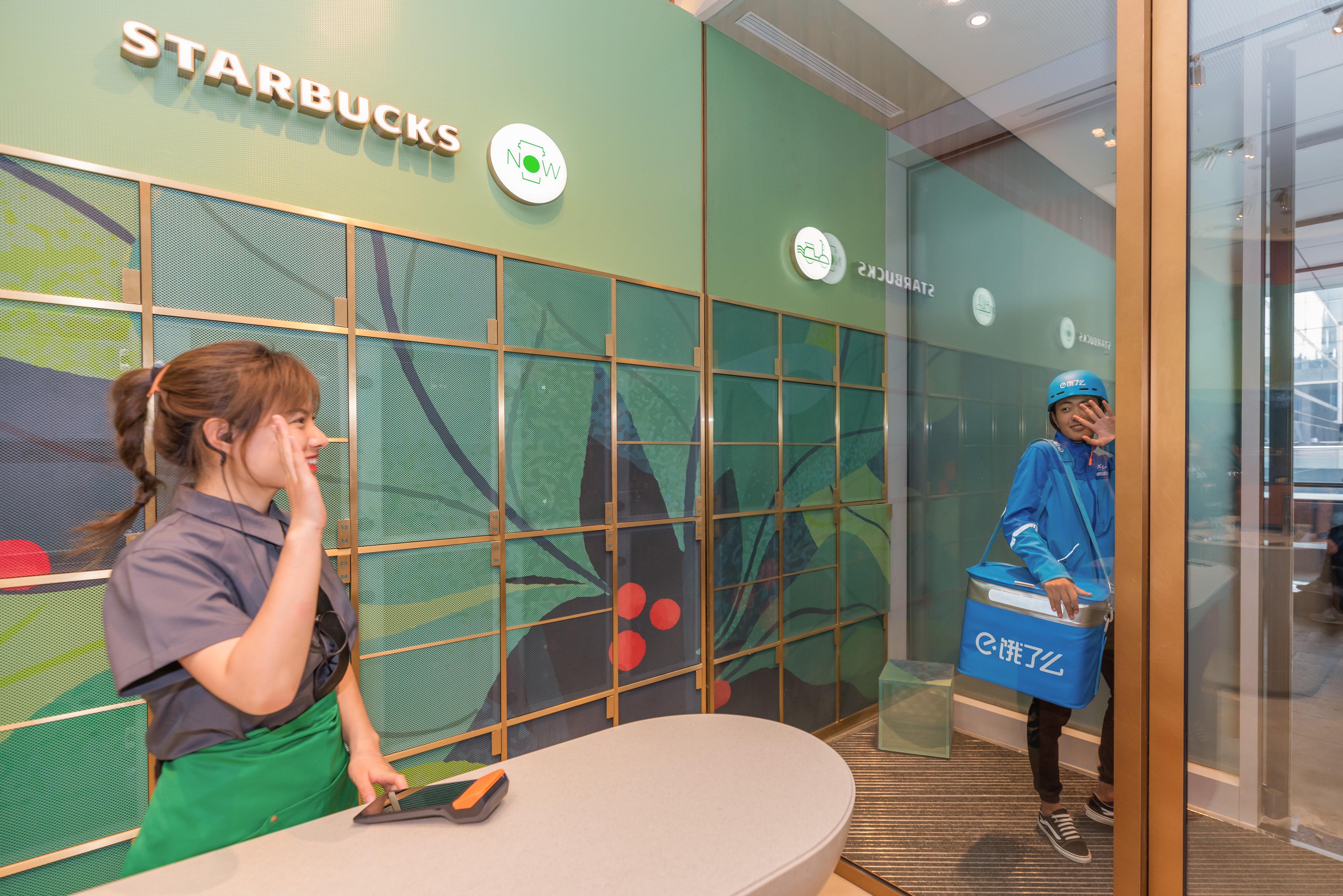 Starbucks barista waving goodbye to delivery girl