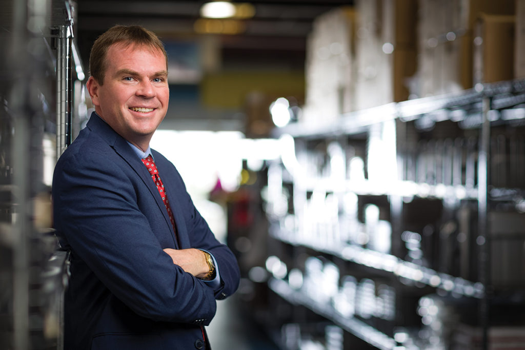 Brad Pierce, President of Restaurant Supply World, photographed at their Orlando location by Jensen Larson for Foodservice Equipment Reports.