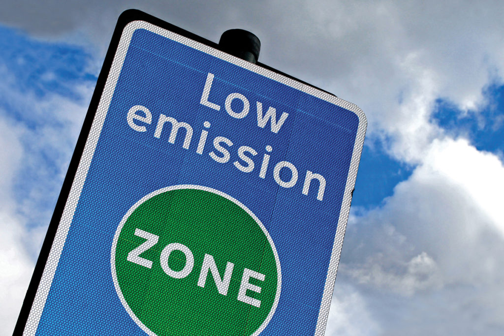 Low emission zone in London aimed at preventing pollution in the City. Metallic Reflective Material.