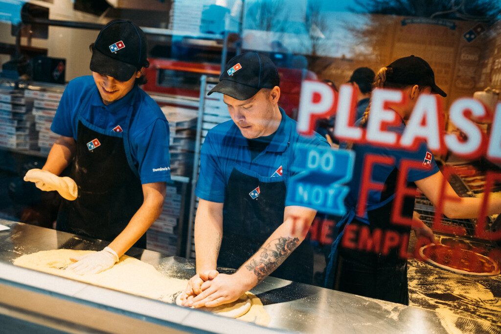 Workers prep pizza dough at a Domino's in Malmo, Sweden. Photo (Courtesy of Domino's) by Pierre Ekman/pierreekman.com