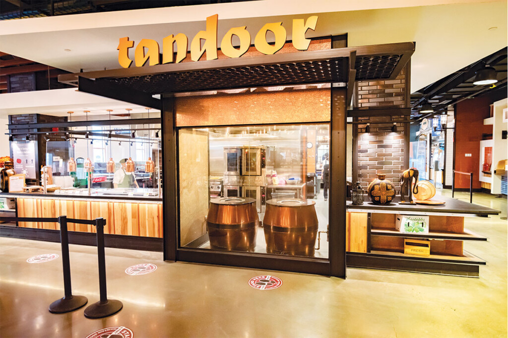 Twin copper-clad tandoor ovens anchor the Indian-food platform. Photos courtesy of Christopher Howland.