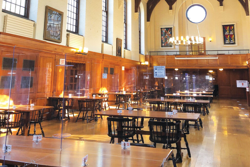 Yale Hospitality cleans and sanitizes the chair, table and safety barrier each time a student dines in a location. Photo by Tony Mastres and Christelle Ramos.