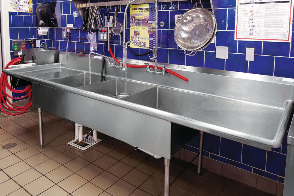 Many makers offer accessories, such as pot racks that install above the sink for storage. Courtesy of Winholt.