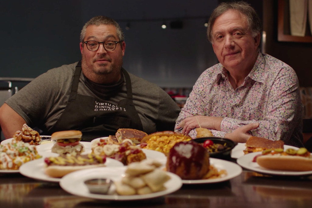 Eric Greenspan (left), culinary director at Virtual Dining Concepts, and Robert Earl, co-founder of VDC, introduce NASCAR Refuel in a promotional video.